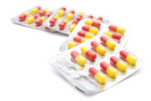 Piles of capsules with clipping path — Stock Photo