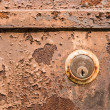 Stock Photo: Old rusty metal plate and lock heavily aged and corroded