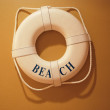 Life buoy hang on a wall — Stock Photo