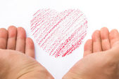 Hands holding a heart sketch — Stock Photo