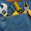 Tools in a blue jean back pocket — Stok fotoğraf