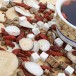Stock Photo: Angle view chinese herbs blends and herb teon wood