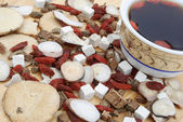 Angle view chinese herbs blends and herb tea on wood — Stock Photo