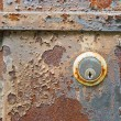 Photo: Old rusty metal plate and lock heavily aged and corroded