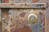 Old rusty metal plate and lock heavily aged and corroded — Stock Photo