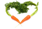 Fresh carrots shaped like a heart — Stock Photo