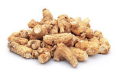 Ginseng stack up on a white background — Stock Photo