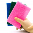 Holding three cleaning sponges — Stock Photo