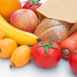 Fresh food stuff and a paper bag - Stock Photo