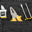 Royalty-Free Stock Photo: Tools in a black jean back pocket