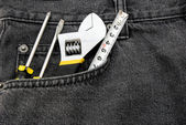 Tools in a black jean front pocket — Stock Photo