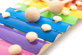 Close up look of colorful xylophone and sticks — Stock Photo