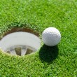 Golf ball very close to the hole — Stock Photo