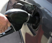 Petrol pump filling — Stock Photo