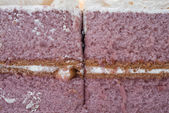 Pattern of lilac cake with cream on top — Stock Photo