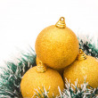 Golden christmas balls on white, vertical — Stock Photo