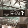 Departure and arrival gates signs in airport — Stock Photo