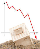House sinking with a downward arrow on background, vertical — Stock Photo