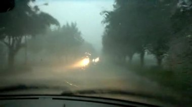 Driving in heavy raining in evening — Wideo stockowe