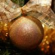 Golden christmas bauble — Stock Photo