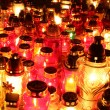 Lighted cemetery candles - Stock Photo