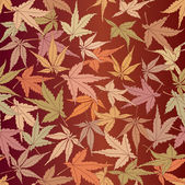 Seamless pattern from autumn maple leaves — Stock Vector