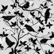 Birds silhouette on branch and leaf seamless background. — Stok Vektör