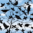 Birds silhouette on branch and leaf seamless background. — Stock vektor