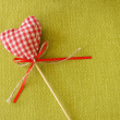Red heart on wooden stick — Stock Photo