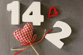 Valentin date 14.2 of white wood letters — Stock Photo
