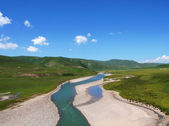 Dried Datong River bed through highland and farm — Stock Photo