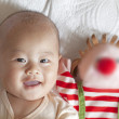 Cute baby smile happily with clown toy — Stock Photo