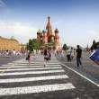 Tourists and the Cathedral of St. Basil — Stock Photo