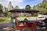 Siem Reap, Cambodia-August 5, 2009: Thousands of tourists visit Angkor's ruins every day. Many go with organized trips and others contract a tuk tuk in order that it does the route to them. Here, a driver of tuk tuk, rests in the car while his touris — Stock Photo