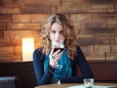 Beautiful Girl In Restaurant holding glass with red wine — Stock Photo
