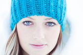 Portrait of beautiful Blonde girl with blue bonnet in winter. — Stock Photo