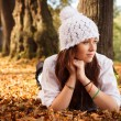 Stock Photo: Beautiful Cute girl in autumn park. Young EuropeTeenager Girl