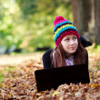 Beautiful young girl with laptop in autumn park. Beautiful Teenager — Stock Photo