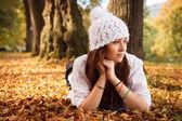 Beautiful Cute girl in autumn park. Young European Teenager Girl — Stock Photo