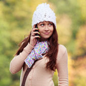 Cute Smiling Girl listening to mobile phone — Stock Photo