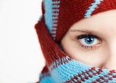Half face portrait of beautiful young woman wearing shawl — Stock Photo