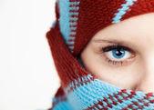 Half face portrait of beautiful young woman wearing shawl — Stock Photo