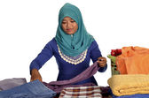Young Muslim Lady folding clothes — Stock Photo