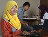 Female Muslim Student with laptop — Stock Photo