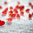 Red heart in glittering snow — Stock Photo #18847177