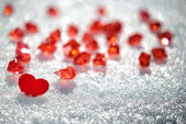 Red heart in glittering snow — Stock Photo