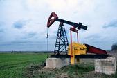Oil pump in field — Stock Photo
