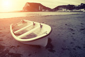 Old boat at sunset — Stock Photo