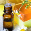 Essential chamomile oil with natural soap — Stock Photo