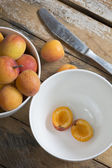 Delicious ripe apricots on wooden table. — Stock Photo